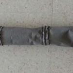 Manga cilíndrica con aros intermedios y extremo cónico con ollao